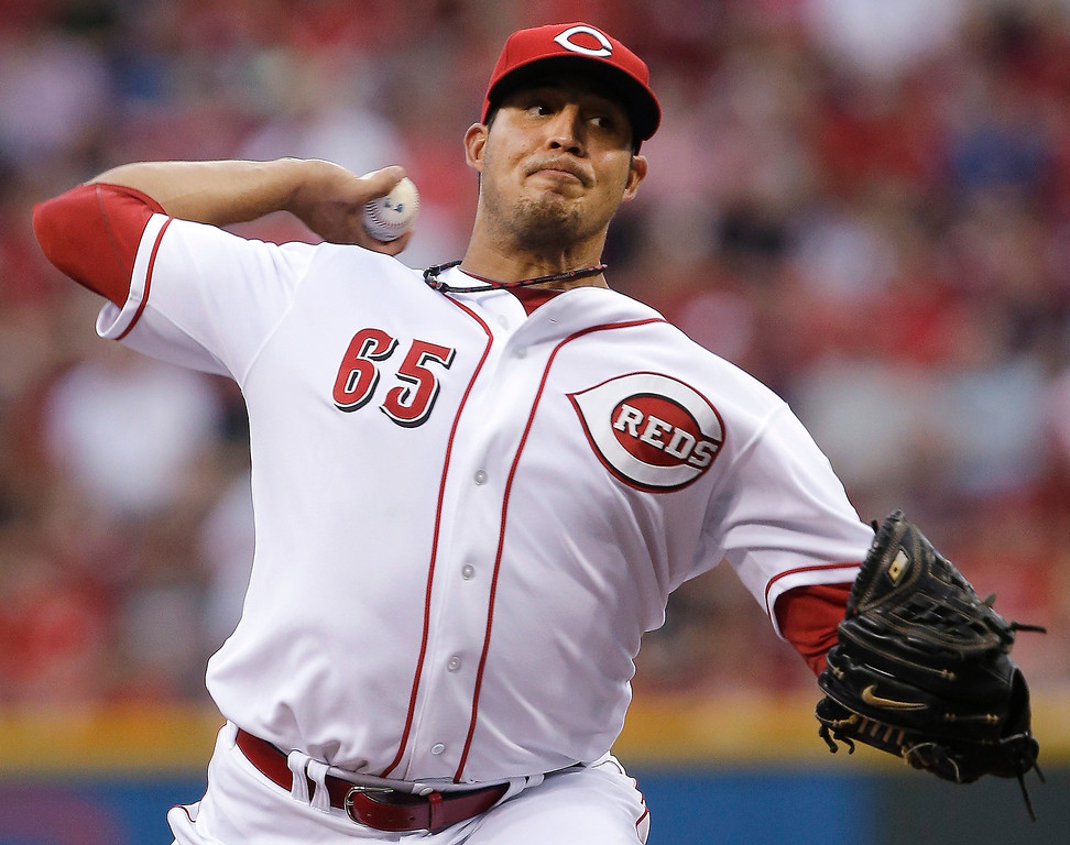 . Cincinnati Reds starting pitcher Pedro Villarreal throws to a Colorado Rockies batter in the first inning of a baseball game, Wednesday, June 5, 2013, in Cincinnati. (AP Photo/Al Behrman)