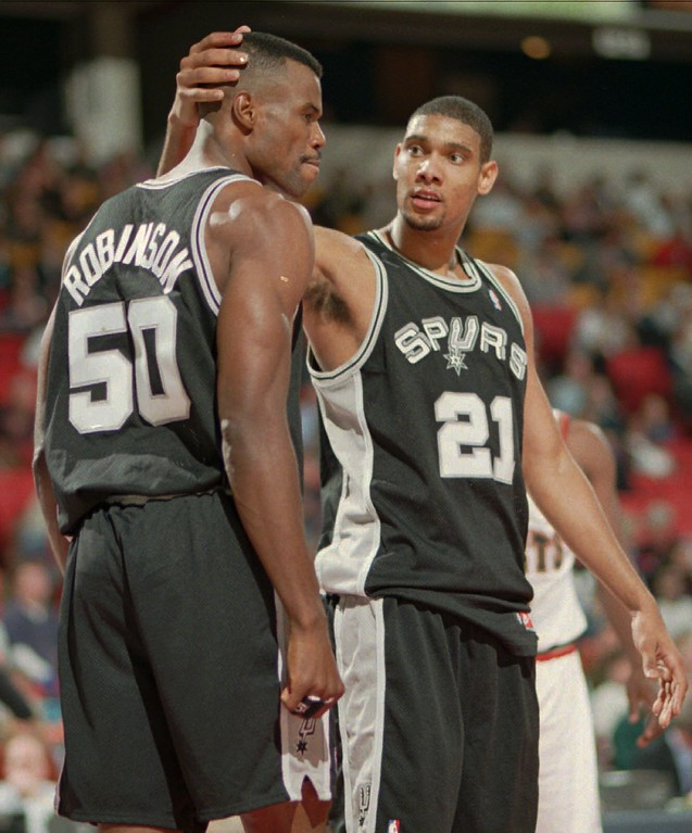 . San Antonio Spurs center David Robinson, left, is congratulated by teammate Tim Duncan after making a basket and drawing a foul in the fourth quarter of the Spurs\' 107-96 victory ove the Denver Nuggets in the season opening-night contest in Denver\'s McNichols Sports Arena on Friday, Oct. 31, 1997. (AP Photo/David Zalubowski)