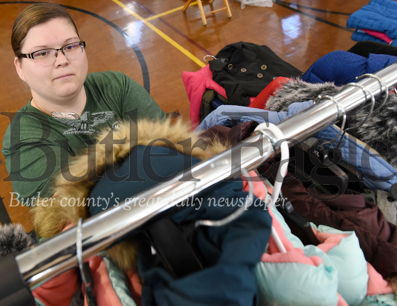 Harold Aughton/Butler Eagle: Lorie Shreckengost, intellectual disabilities support coordinator for the Community for Resource Center, keeps the coat racks full during the Bundle up Butler event Tues., Oct. 29.