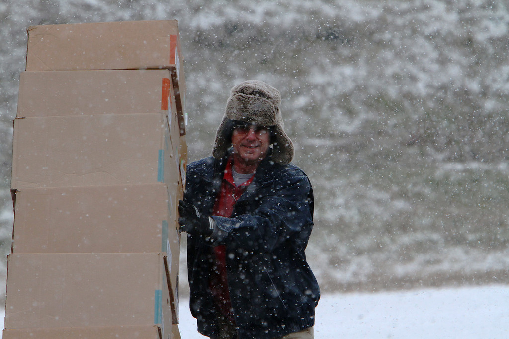 . Frito Lay employee Ray Harris delivers chips to a store in Childersburg Alabama as a snow and ice storm came to the south Tuesday Jan. 28,  2014.  A fast-moving, unexpectedly severe winter storm blanketed much of Alabama with a treacherous layer of frozen precipitation Tuesday.   (AP Photo/Hal Yeager)