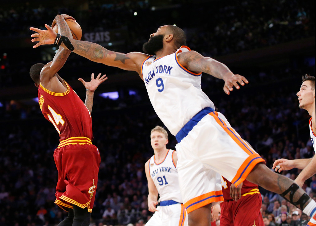 . Cleveland Cavaliers guard DeAndre Liggins (14) steals the ball from New York Knicks center Kyle O\'Quinn (9) in the second half of an NBA basketball game at Madison Square Garden in New York, Wednesday, Dec. 7, 2016. The Cavaliers defeated the Knicks 126-94. (AP Photo/Kathy Willens)