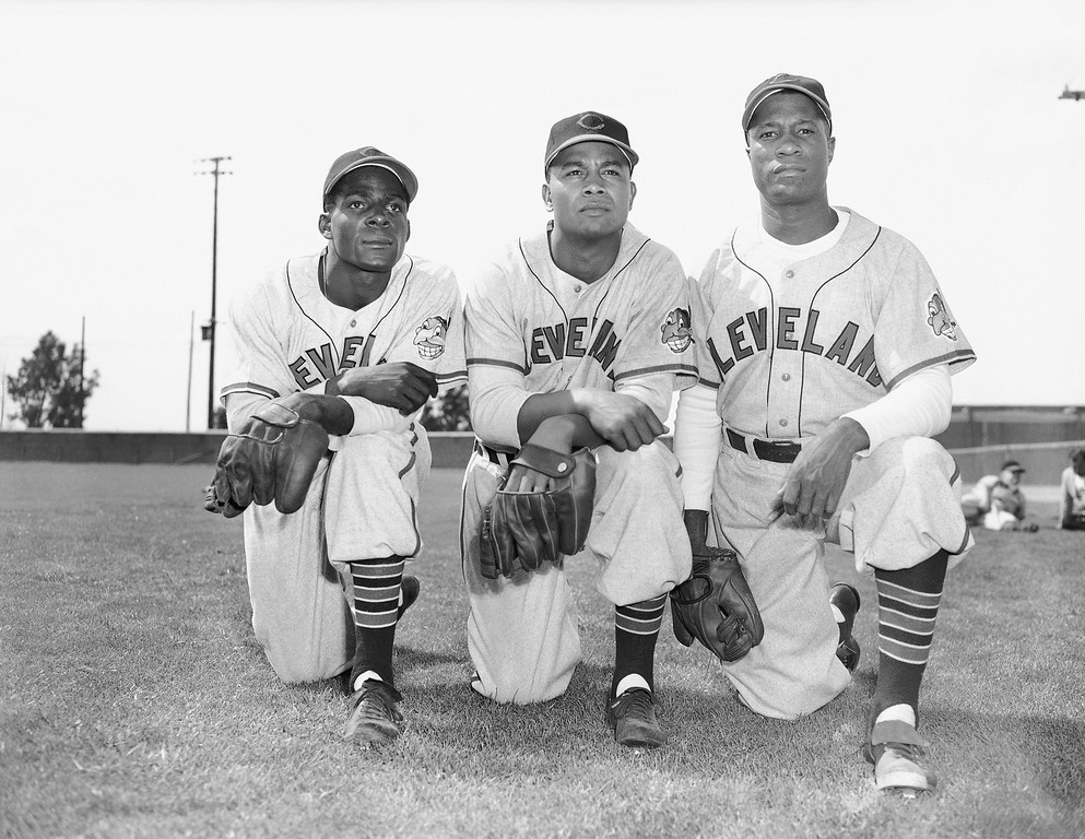 . Cleveland Indians Orestes Minoso of Cuba, left, shown with teammates Larry Doby, center, and Roy Welmaker, right, was farmed out by Cleveland to Dayton and in 11 games he hit better than .500.  They are shown in Tucson at their spring training camp, March 4, 1949. (AP Photo/Frank Filan)