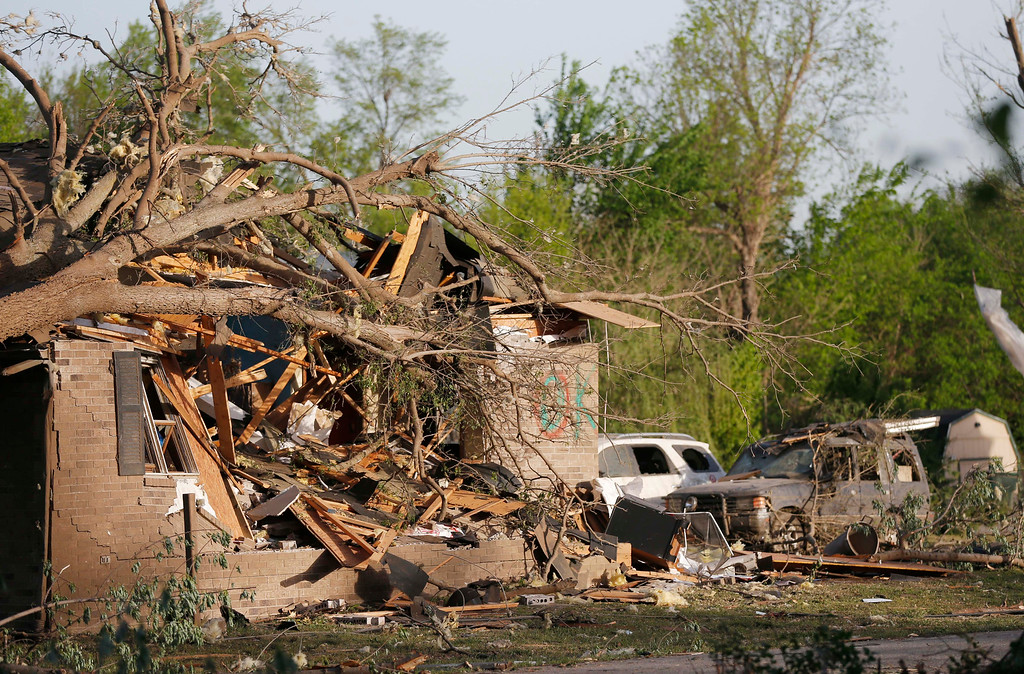 . A tornado-damaged home awaits clean up and repairs after a Sunday tornado in Baxter Springs, Kan., Monday, April 28, 2014. Sunday\'s tornado damaged dozens of buildings and injured at least 25 people. (AP Photo/Orlin Wagner)