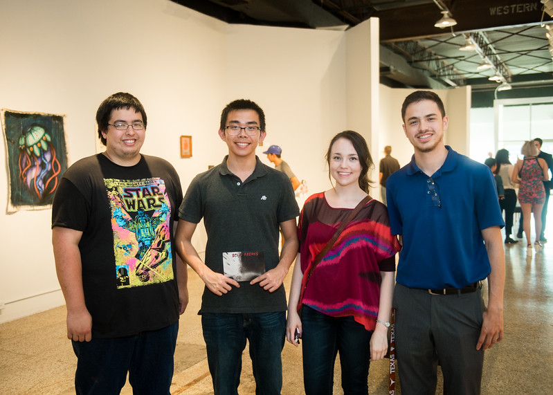 David Schumacher (Left) Ker Xiang Teh, Kaela Mathis, Josh Torres enjoy the showing at the Islander Art Gallery.