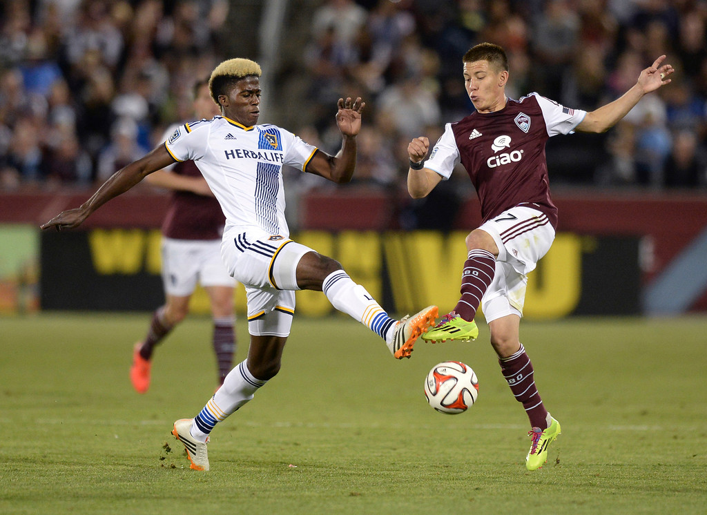 . COMMERCE CITY, CO - MAY 3:  Los Angeles forward Gyasi Zardes (11) and Colorado midfielder Dillon Serna (17) went for the ball in the second half. The Colorado Rapids defeated the Los Angeles Galaxy 1-0 Saturday night, May 3, 2014 at Dick\'s Sporting Good Park. (Photo by Karl Gehring/The Denver Post)
