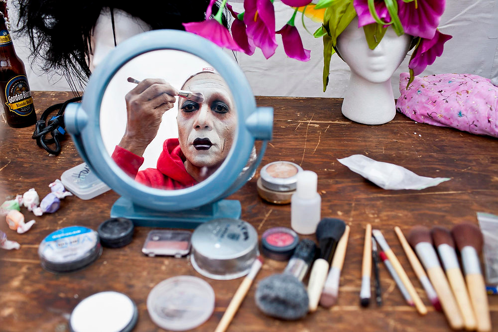 Description of . Sister Pat N Leather, a members of the group The Sisters of Perpetual Indulgence, puts on make up before taking part in Project Nunway, a charity fashion show where designers are paired with Sisters to create fashions from recycled materials, in San Francisco, December 2, 2012.  The Sisters of Perpetual Indulgence (SPI) is a charity and street performance organization founded in 1979 which uses religious imagery to raise money for AIDS, LGBT-related causes, and mainstream community service organizations.   Picture taken December 2, 2012.  REUTERS/Jana Asenbrennerova