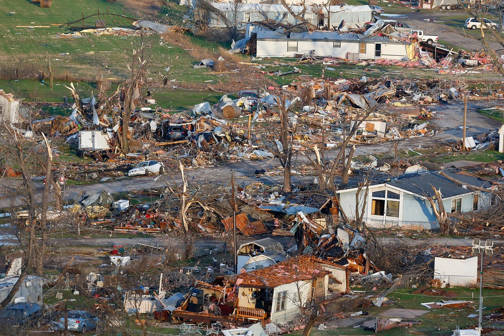 . This aerial photo shows storm damage of the River Oaks Mobile Home Park in Sand Springs, Okla., on Thursday, March 26, 2015.  The first batch of severe weather in this year\'s tornado season devastated the mobile home park, as storms across the area damaged buildings, tore off roofs and left debris strewn across roads.  (AP Photo/Tulsa World,  Tom Gilbert)