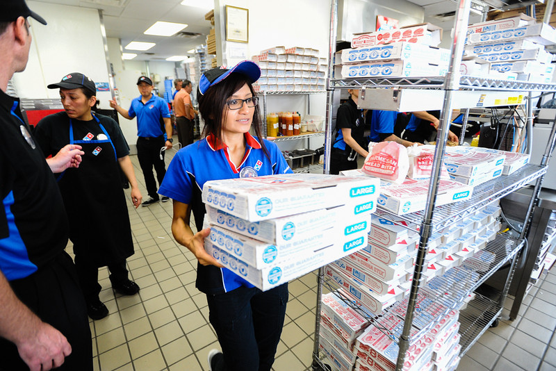 . Thirty-three-year-old Daniela Busald, younger sister of slain Domino\'s Pizza shift manager Nelly Kantun, delivers carry-out pizza orders to customers during a memorial fundraiser for Kantun at Domino\'s Pizza on Highland Avenue in San Bernardino, CA on Wednesday, Feb. 19, 2014. Kantun worked as a Domino\'s employee for more than 20 years, and the pizza location she worked at planned to donate 100 percent of the proceeds earned Wednesday to the memorial fund. (Photo by Rachel Luna / San Bernardino Sun)