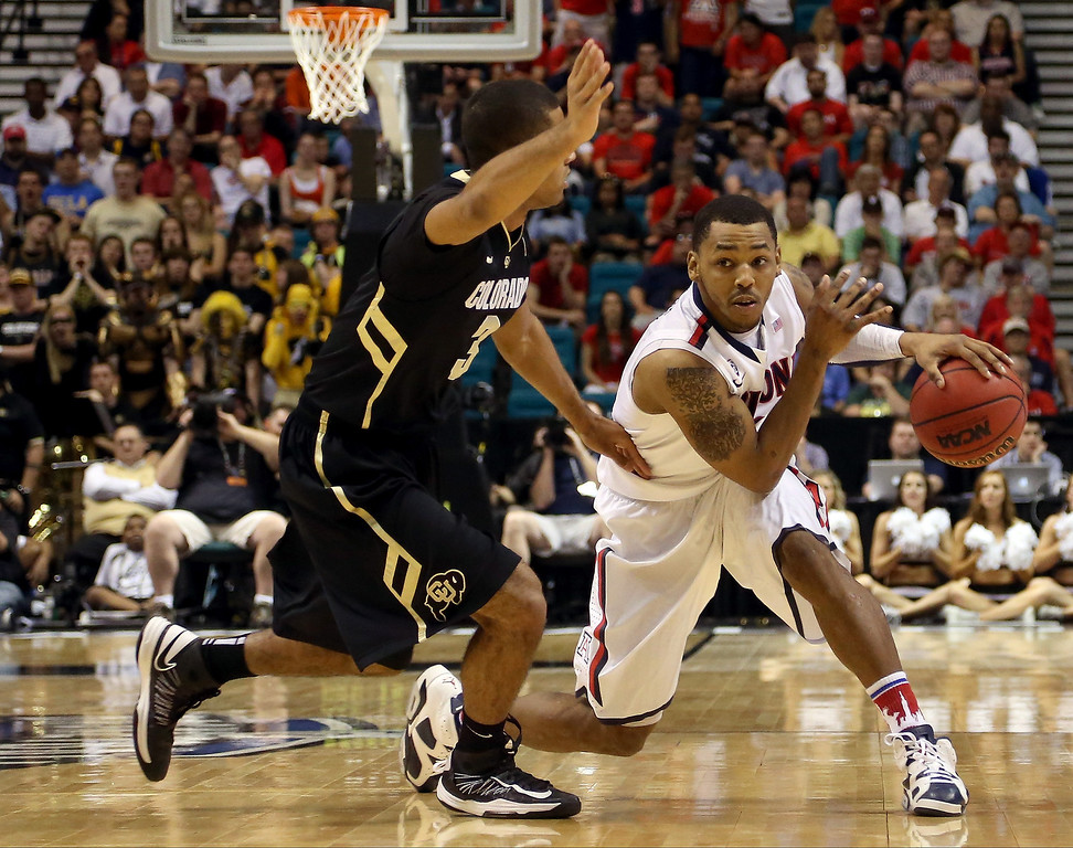 . Mark Lyons #2 of the Arizona Wildcats looks to drive on Xavier Talton #3 of the Colorado Buffaloes in the second half during the quarterfinals of the Pac-12 tournament at the MGM Grand Garden Arena on March 14, 2013 in Las Vegas, Nevada.  (Photo by Jeff Gross/Getty Images)