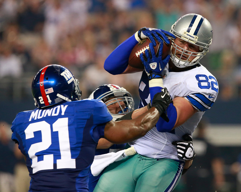 . Dallas Cowboys tight end Jason Witten (82) pull in a touchdown against New York Giants free safety Ryan Mundy (21) and Mark Herzlich (58) during the first half of an NFL football game, Sunday, Sept. 8, 2013, in Arlington, Texas. (AP Photo/Waco Tribune Herald,  Jose Yau)