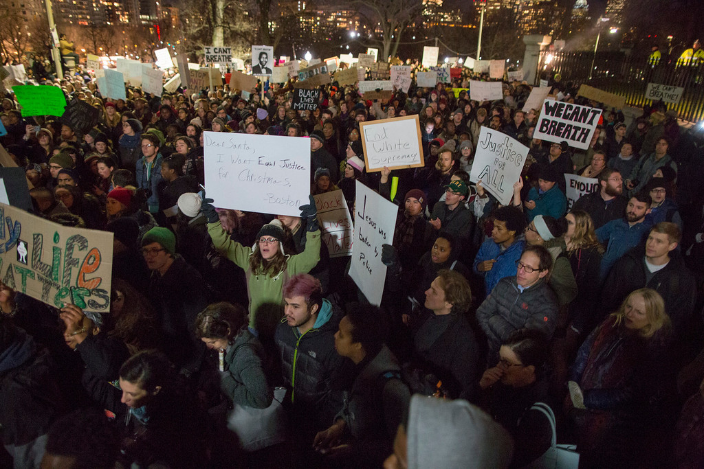 . Thousands of protesters assemble at the State House steps during a protest against the decision by a Staten Island grand jury not to indict a police officer who used a chokehold in the death of Eric Garner in July, on December 4, 2014 in Boston, Massachusetts. The grand jury declined to indict New York City Police Officer Daniel Pantaleo in Garner\'s death. (Photo by Scott Eisen/Getty Images)