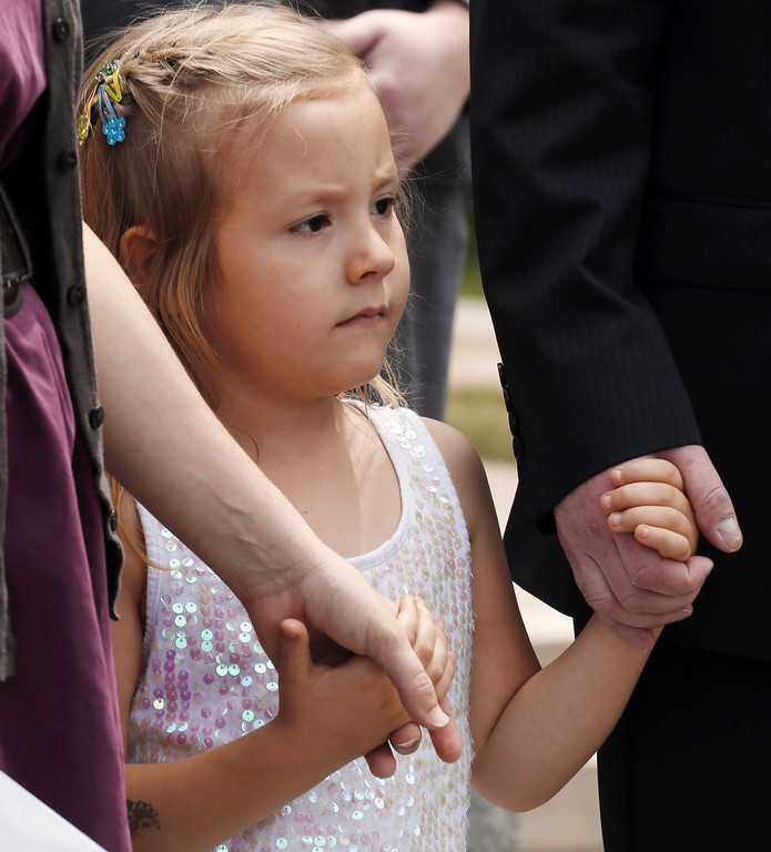 . Six-year-old transgender girl Coy Mathis holds hands with her attorney Michael Silverman and her mother Kathryn Mathis at a news conference at the Capitol in Denver on Monday, June 24, 2013. The Colorado Civil Rights Division has ruled in favor of  Coy Mathis, whose school had barred her from using the girls\' bathroom at her elementary school because she is transgender.  (AP Photo/Ed Andrieski)