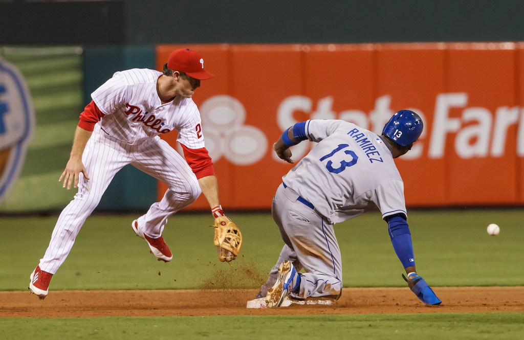 . Los Angeles Dodgers\' Hanley Ramirez steals second base as Philadelphia Phillies second baseman Chase Utley looks at the throw during the ninth inning of a baseball game, Friday, Aug. 16, 2013, in Philadelphia. The Dodgers won 4-0. (AP Photo/Christopher Szagola)