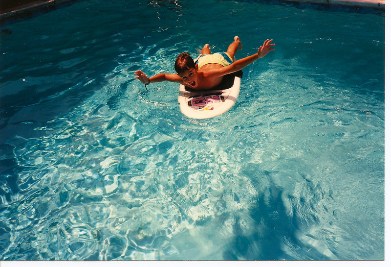 Mike rocking the boogie board ... in a pool.