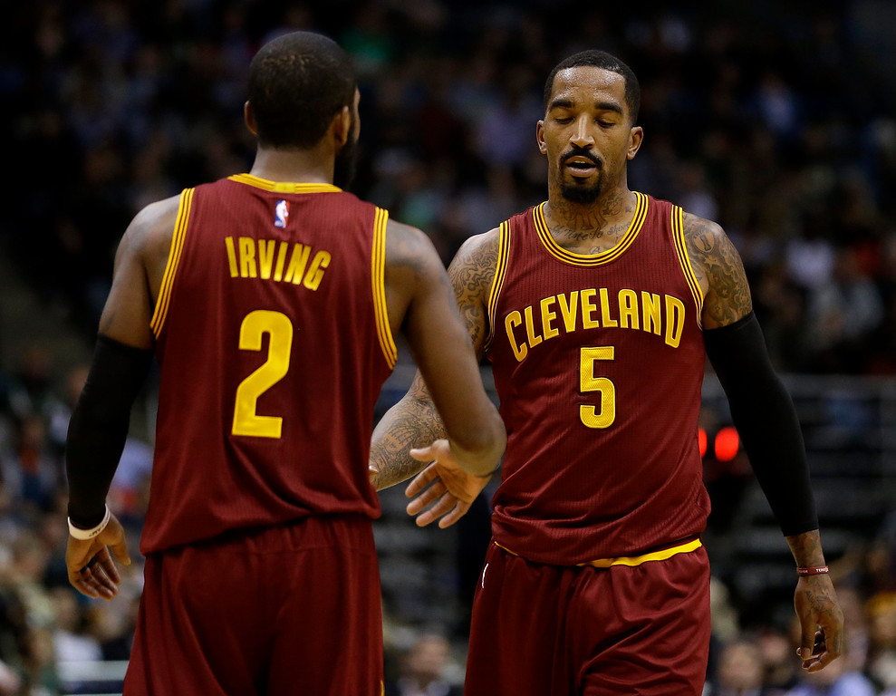 . Cleveland Cavaliers\' J.R. Smith (5) and Kyrie Irving (2) during an NBA basketball game against the Milwaukee Bucks Tuesday, Nov. 29, 2016, in Milwaukee. (AP Photo/Aaron Gash)
