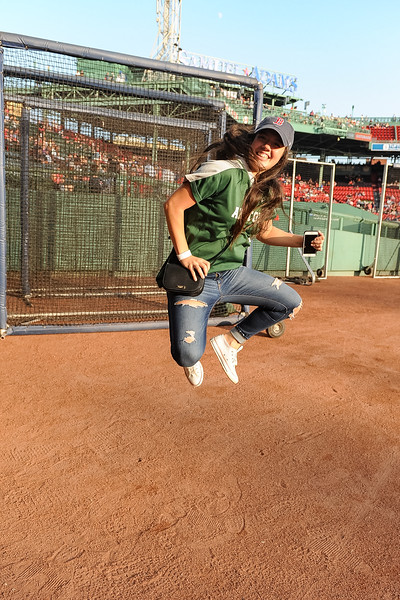 Abington High School Softball player Lauren Keleher jumps for joy prior to being introduced to the crowd at the Red Sox game vs Cleveland on 8/20/18 at Fenway Park [Courtesy Photo/Bill Marquardt]