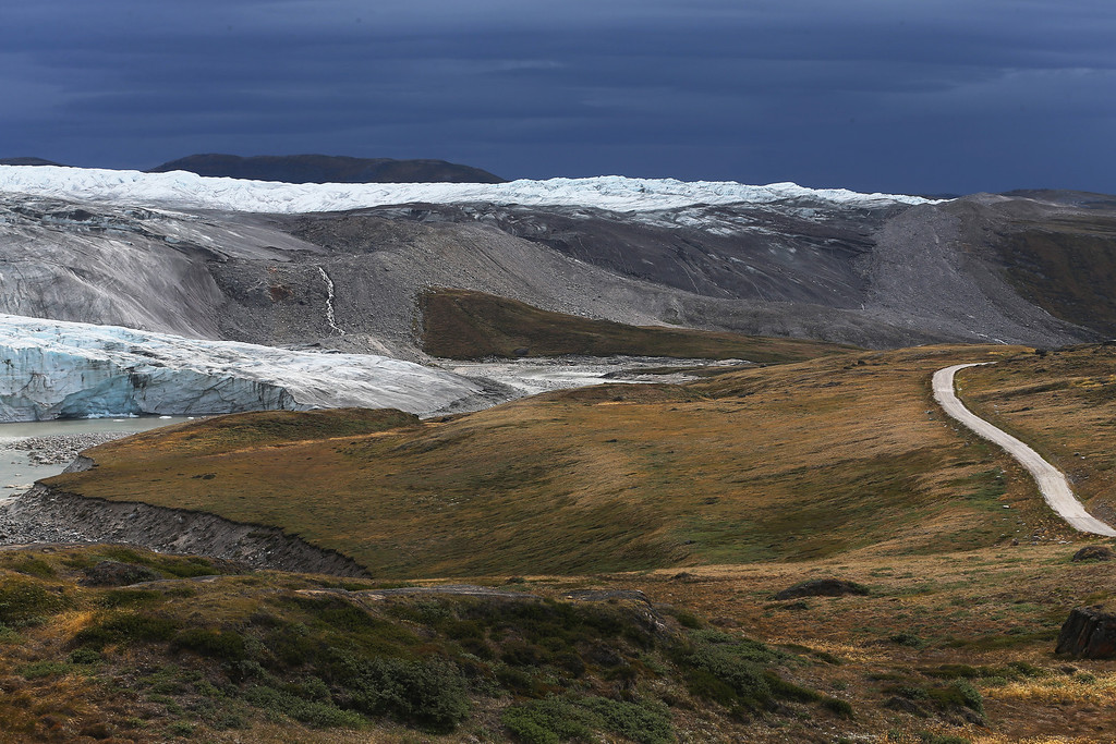 . A glacier is seen on July 12, 2013 in Kangerlussuaq, Greenland.  As the sea levels around the globe rise, researchers affiliated with the National Science Foundation and other organizations are studying the occurrence of the melting glaciers and its long-term ramifications.  (Photo by Joe Raedle/Getty Images)