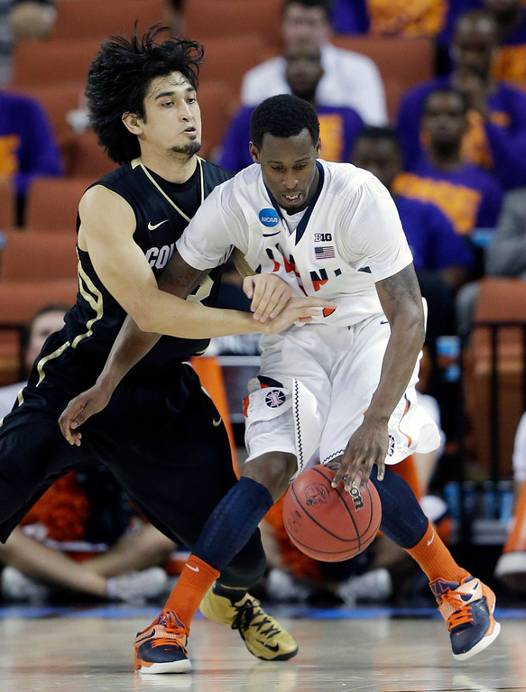 . Illinois\' D.J. Richardson, right, is pressured by Colorado\'s Sabatino Chen, left, during the second half of a second-round game of the NCAA college basketball tournament on Friday, March 22, 2013, in Austin, Texas. Illinois defeated Colorado 57-49. (AP Photo/Eric Gay)
