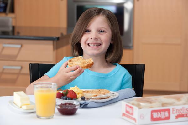 Girl Eating Bays English Muffins.jpg