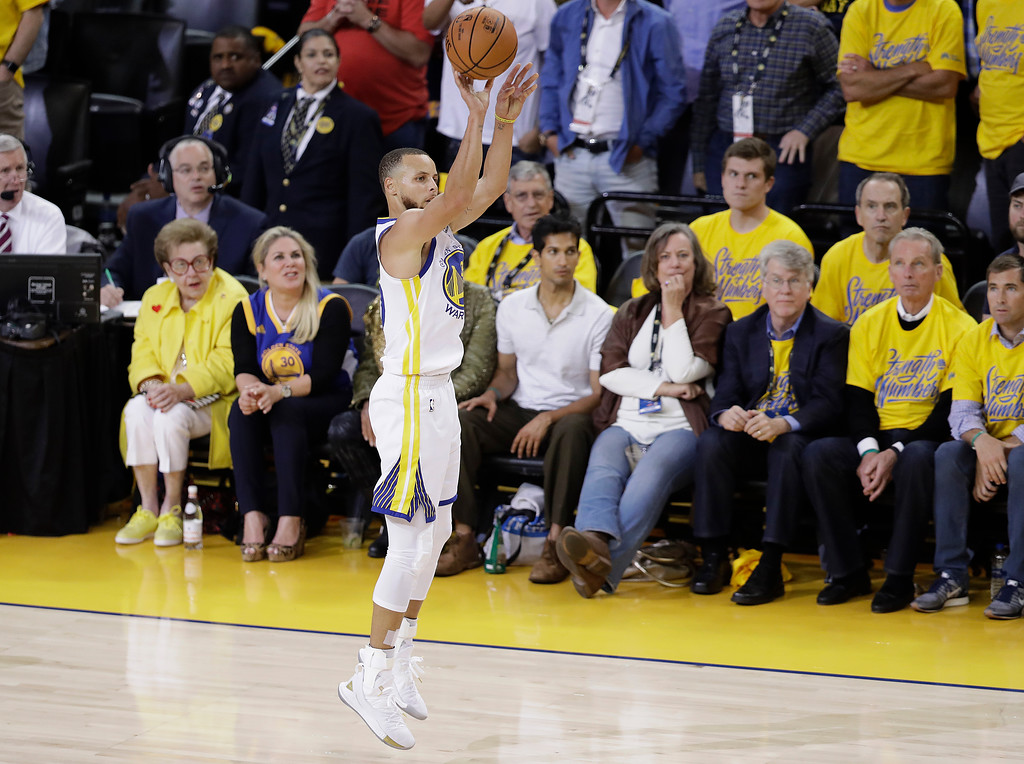 . Golden State Warriors guard Stephen Curry shoots a 3-point basket against the Cleveland Cavaliers during the first half of Game 1 of basketball\'s NBA Finals in Oakland, Calif., Thursday, May 31, 2018. (AP Photo/Marcio Jose Sanchez)