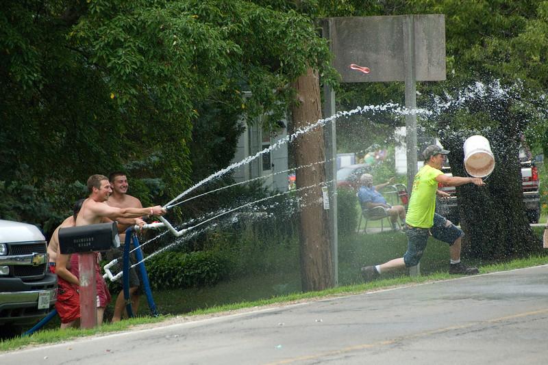 Onlookers tossing water during Stephensville Parade, Wisconsin