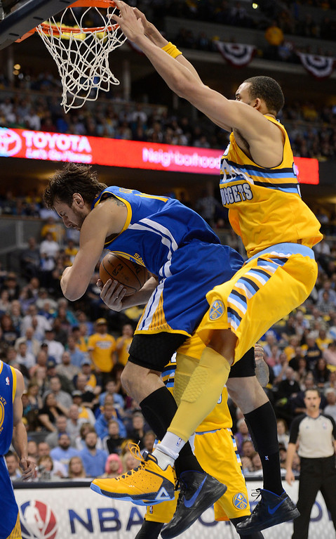 . DENVER, CO. - APRIL 20: Golden State Warriors center Andrew Bogut (12) grabs a rebound underneath Denver Nuggets center JaVale McGee (34) in the second quarter. The Denver Nuggets took on the Golden State Warriors in Game 1 of the Western Conference First Round Series at the Pepsi Center in Denver, Colo. on April 20, 2013. (Photo by John Leyba/The Denver Post)
