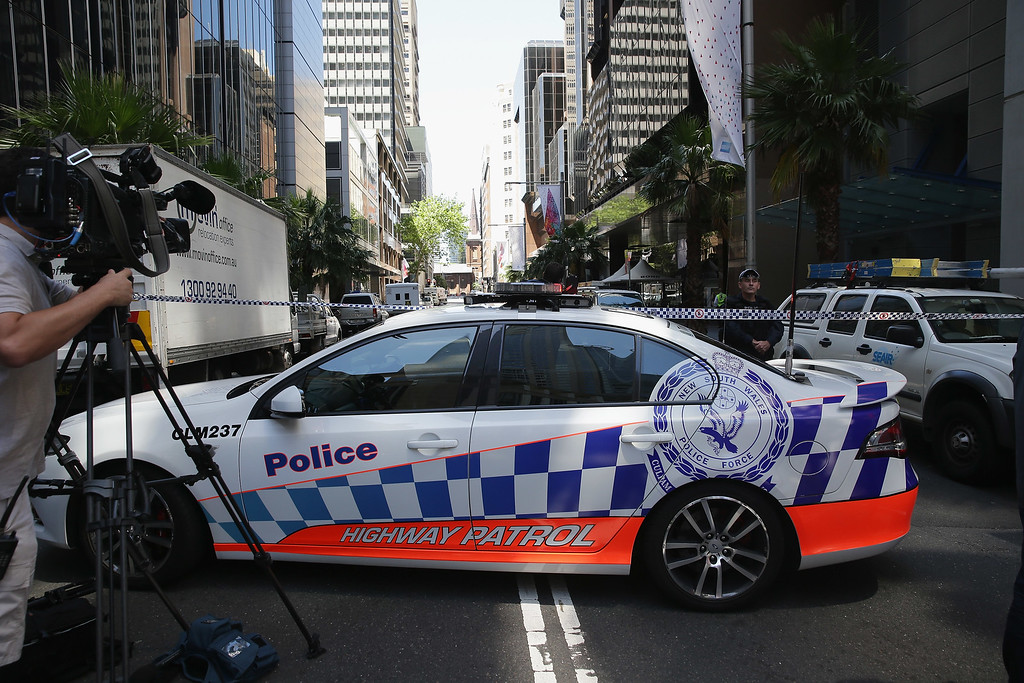. SYDNEY, AUSTRALIA - DECEMBER 15:  Police secure the scene near Lindt Cafe, Martin Place on December 15, 2014 in Sydney, Australia.  Major landmarks in Sydney, including the Sydeny Opera House, have been evacuated as police respond to a hostage situation inside a Martin Place cafe.  (Photo by Don Arnold/Getty Images)