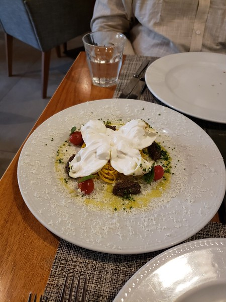 fresh burrata, olive paste, and white chocolate sprinkles at Mondo's Italian Restaurant