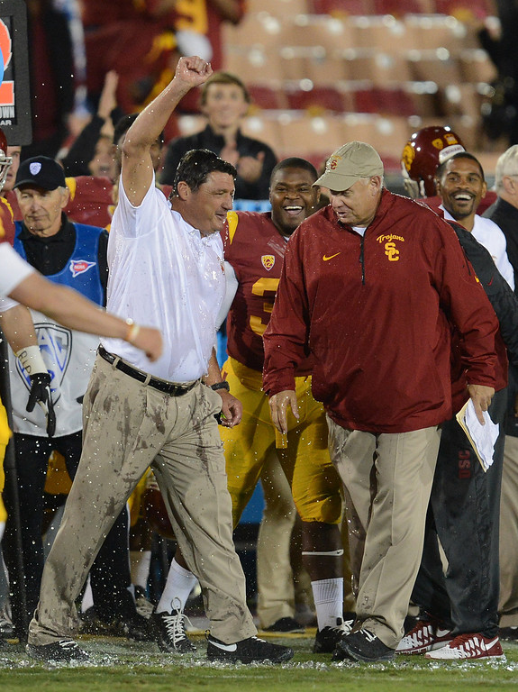 . USC interim coach Ed Orgeron pumps his fist in the air after the clock expires during their game against Arizona at the Los Angeles Memorial Coliseum Thursday, October 10, 2013. USC defeated Arizona 38-31. (Photo by Hans Gutknecht/Los Angeles Daily News)