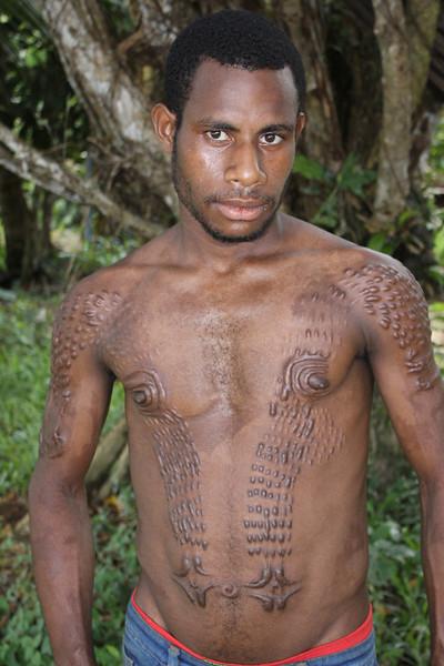 knife cut crocodile pattern on boy as initiation into manhood