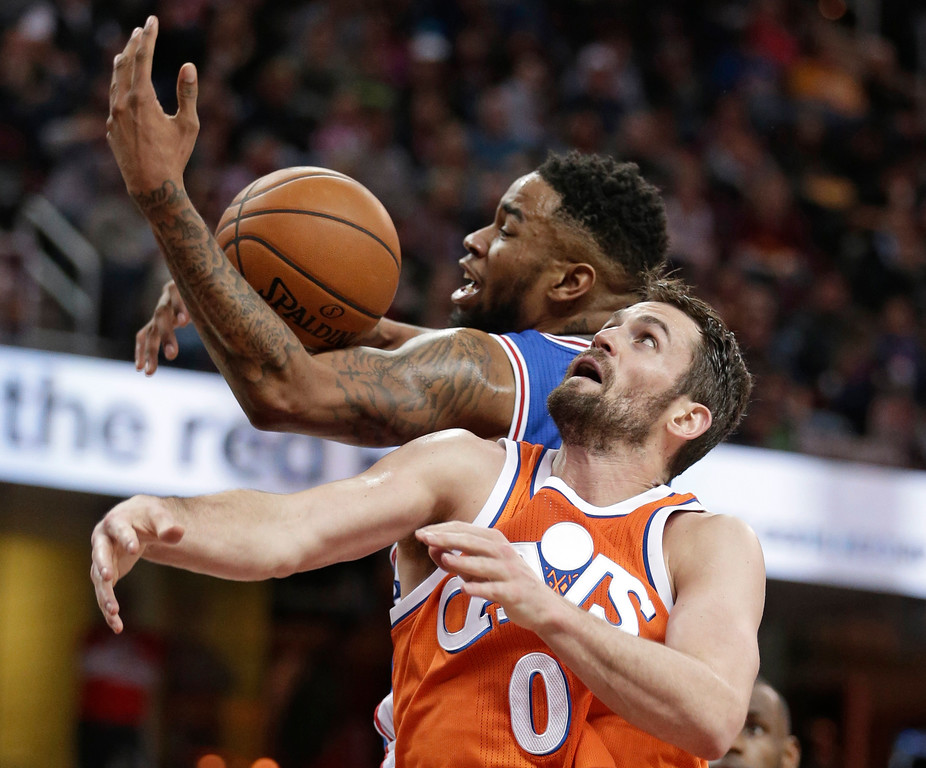 . Philadelphia 76ers\' Shawn Long, top, and Cleveland Cavaliers\' Kevin Love battle for a rebound in the second half of an NBA basketball game, Friday, March 31, 2017, in Cleveland. (AP Photo/Tony Dejak)