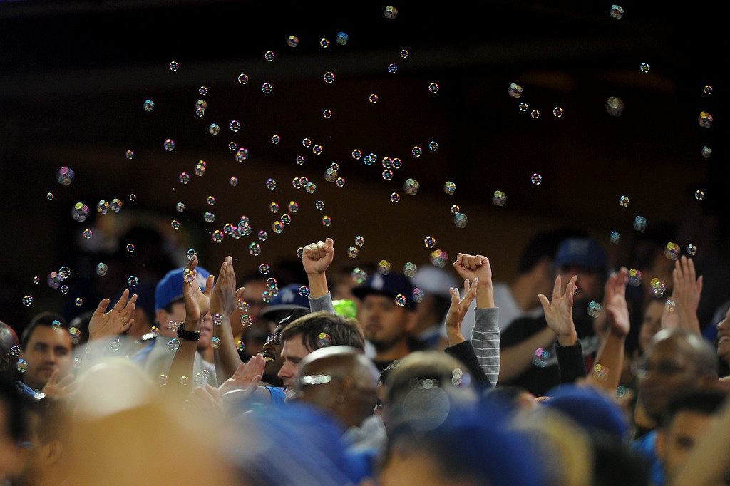 . Bubbles make an appearance during the seventh-inning stretch, Friday, July 11, 2014, at Dodger Stadium. (Photo by Michael Owen Baker/Los Angeles Daily News)