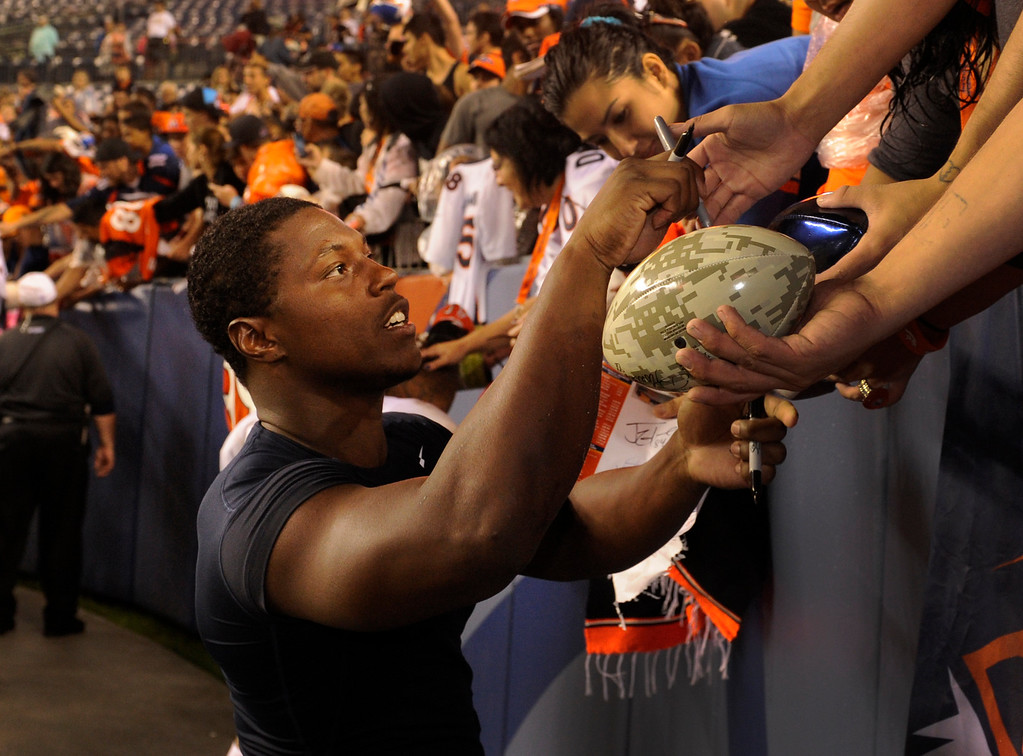 . DENVER, CO. - AUGUST 03: Knowshon Moreno lingered as fans requested signatures Saturday night. The Denver Broncos signed autographs for fans after practicing in the rain at Sports Authority Field Saturday night, August 3, 2013. Photo By Karl Gehring/The Denver Post
