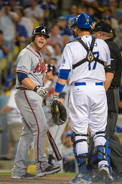 . Atlanta\'s Freddie Freeman argues with Dodger\'s A.J. Ellis after striking out during game action Monday, October 7, 2013 ( Photo by Andy Holzman/Los Angeles Daily News )