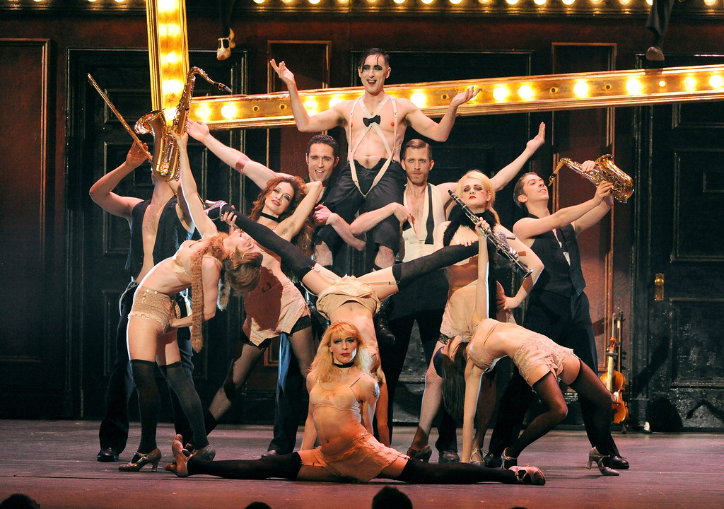 ". Alan Cumming, center top, and the cast of ""Cabaret\"" perform on stage at the 68th annual Tony Awards at Radio City Music Hall on Sunday, June 8, 2014, in New York. (Photo by Evan Agostini/Invision/AP)"