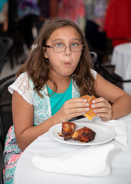 Young Guest Eating at Rehearsal Dinner.jpg