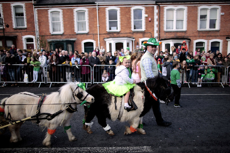 . A child rides on a pony during the St. Patrick\'s Day parade in Limerick, Ireland, Sunday, March 17, 2013.  (AP Photo/Peter Morrison)