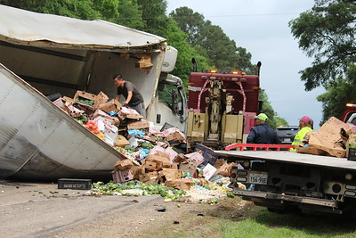 Produce truck spill on US 96 N about 5 miles north of Center