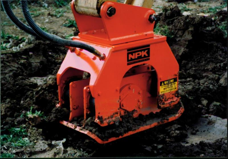 NPK C4C compactor with narrow baseplate on backhoe at NPKCE (2).JPG