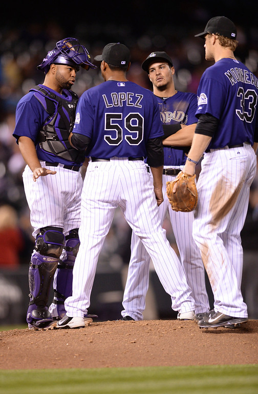 . Teammates came to the mound as reliever Wilton Lopez was being yanked from the game in the eighth inning. The Colorado Rockies hosted the Chicago White Sox Tuesday night, April 8, 2014 at Coors Field in Denver.  (Photo by Karl Gehring/The Denver Post)