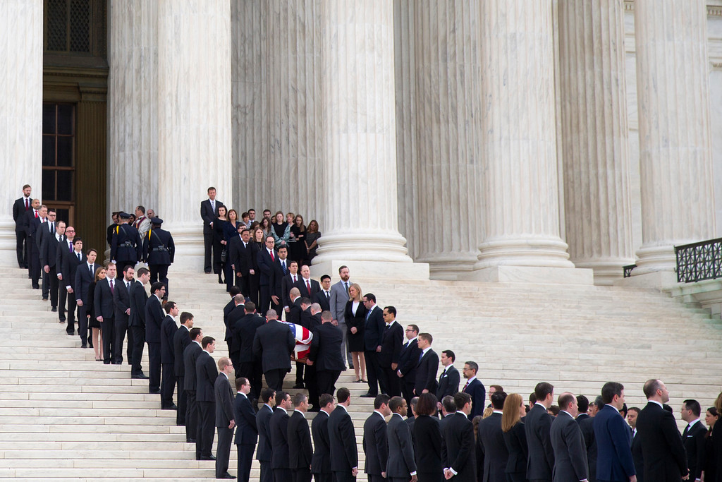 . The body of  Supreme Court Justice Antonin Scalia arrives at the Supreme Court in Washingotn,  Friday, Feb. 19, 2016. Thousands of mourners will pay their respects Friday for Justice Antonin Scalia as his casket rests in the Great Hall of the Supreme Court, where he spent nearly three decades as one of its most influential members. (AP Photo/Evan Vucci)