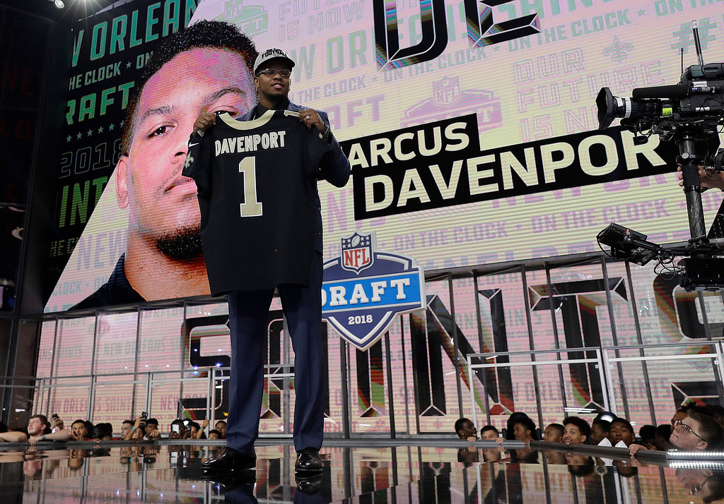 . UTEP\'s Marcus Davenport poses with his New Orleans Saints jersey after being selected by the team during the first round of the NFL football draft, Thursday, April 26, 2018, in Arlington, Texas. (AP Photo/David J. Phillip)