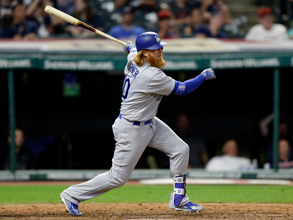. Los Angeles Dodgers\' Justin Turner hits a single off Cleveland Indians relief pitcher Dan Otero in the ninth inning of an interleague baseball game, Tuesday, June 13, 2017, in Cleveland. (AP Photo/Tony Dejak)