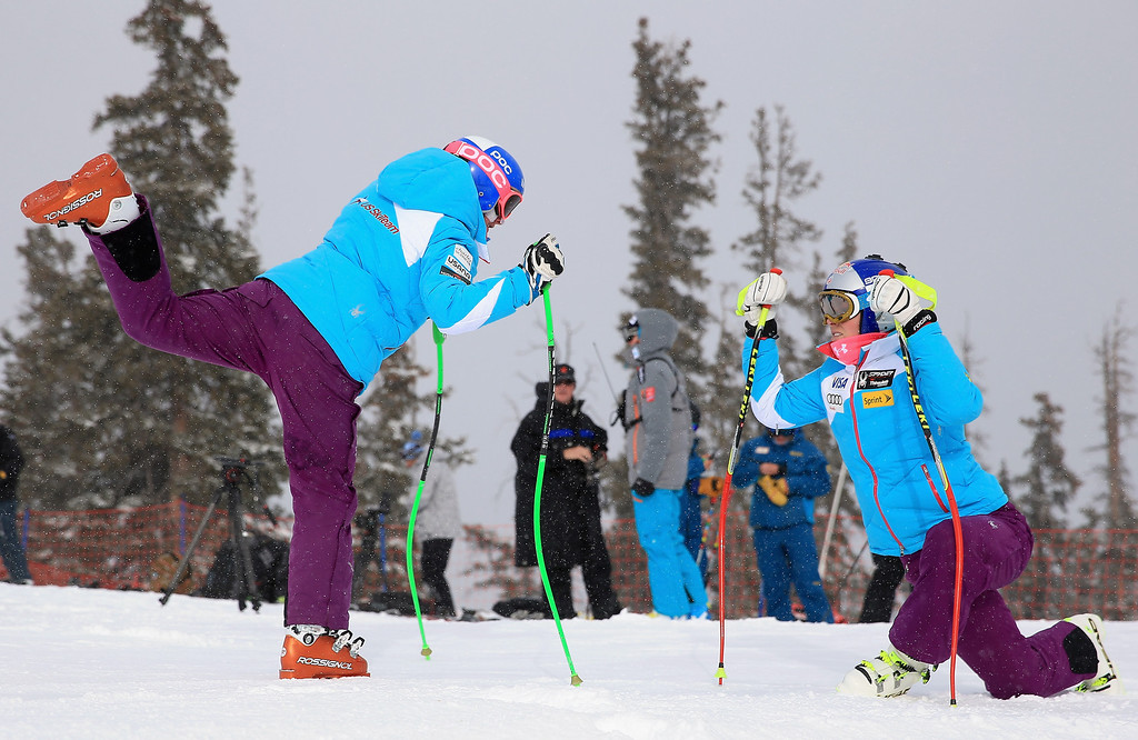 . Stacey Cook, left,  and Lindsey Vonn stretch as they prepare for downhill training at the U.S. Ski Team Speed Center at Copper Mountain on November 6, 2013 in Copper Mountain, Colorado.  (Photo by Doug Pensinger/Getty Images)