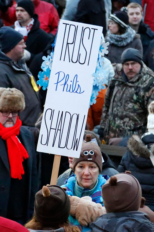 . A member of the crowd at Gobbler\'s Knob for the 131st celebration of Groundhog Day, holds a sign after the forecast by Punxsutawney Phil, the weather prognosticating groundhog, in Punxsutawney, Pa. Thursday, Feb. 2, 2017. Phil\'s handlers said that the groundhog has forecast six more weeks of winter weather. (AP Photo/Gene J. Puskar)