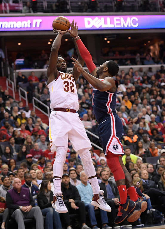 . Cleveland Cavaliers forward Jeff Green (32) shoots against Washington Wizards guard John Wall, right, during the first half of an NBA basketball game, Sunday, Dec. 17, 2017, in Washington. (AP Photo/Nick Wass)