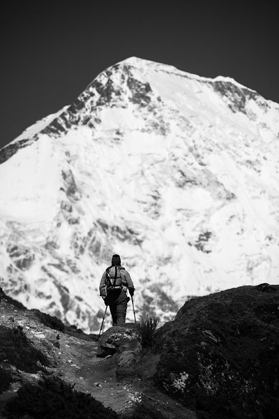 Trekker hiking in front of Mount Everest - Nepal - Solukhumbu District