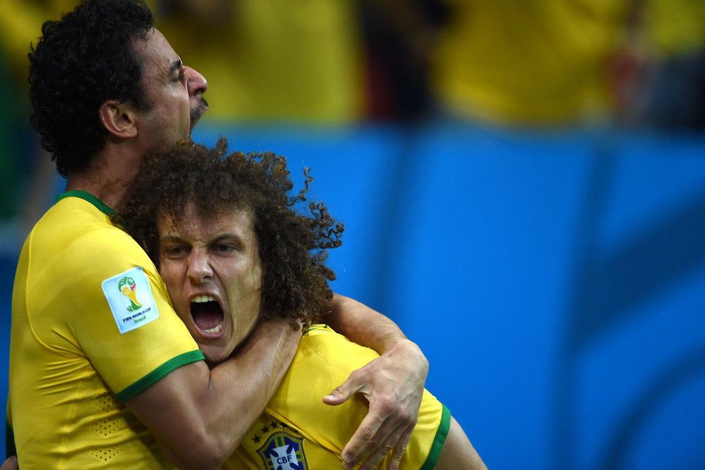 . Brazil\'s forward Fred (L) celebrates with Brazil\'s defender David Luiz after scoring during a Group A football match between Cameroon and Brazil at the Mane Garrincha National Stadium in Brasilia during the 2014 FIFA World Cup on June 23, 2014.    FRANCOIS XAVIER MARIT/AFP/Getty Images