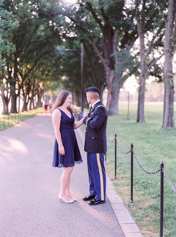 Washington Memorial engagement session with Lisa and Charlie. National Mall engagement session in Washington, DC. Lisa is in a beautiful chiffon dress. Charlie wore his dress blues. The engagement session features the Washington Memorial, Lincoln Memorial, the WWII Memorial, and the DC War Memorial.