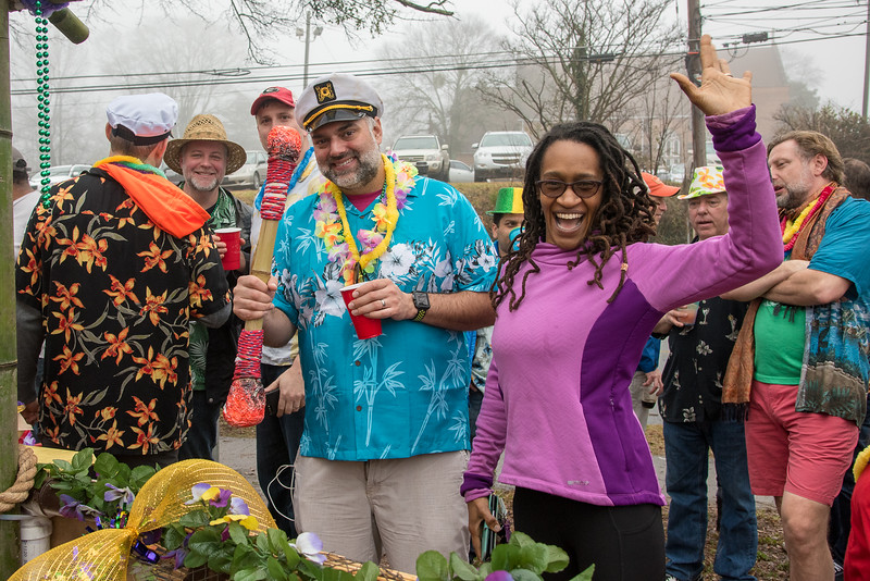 Vijay Maka and Stella Helms give a hardy cheer to everyone attending the 2018 Mead Rd. Mardi Gras parade at The Imperial Oakhurst.  Aye aye, Captain.